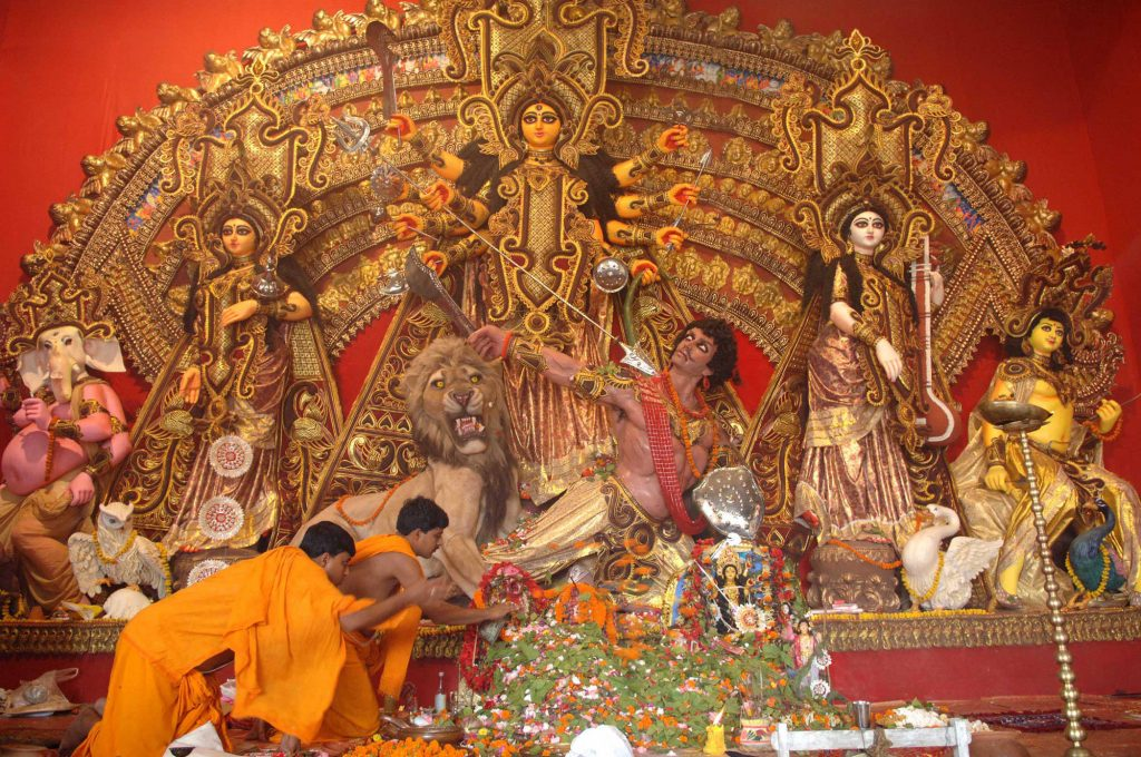 The Priest in the final rituals of immersing the Darpan to mark the completion of the five Durga Puja Festival on the Maha Dashami at Kolkata on October 21, 2007.